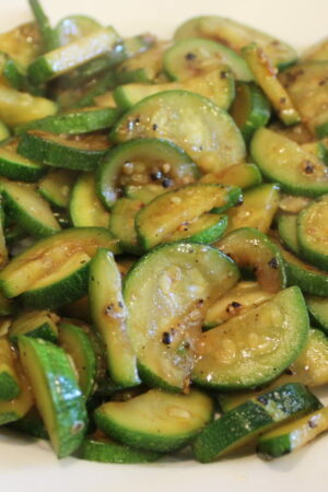 A big platter is full of sauteed zucchini glazed with a simple Asian Hoisin sauce glaze.