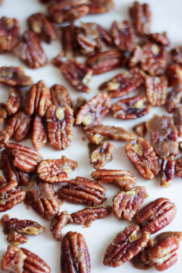 A trey of lightly candied pecans scattered on it. The pecans have just a touch of brown sugar and are lightly sweet and crunchy.