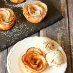 These Apple Rose Pie treats only look complicated! It is easy to make this beautiful treat for Mother's Day, or a special dinner. Apple slices are wrapped in puff pastry with a cream cheese and Apple Beer sauce and then rolled into roses. Dress it up with a drizzle of salted caramel sauce or a dusting of powdered sugar.