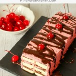 Chocolate Covered Cherry Ice Cream Sandwich Cake is a simple summer treat anybody can make in 20 minutes. My amazing recipe for hot fudge sauce is included