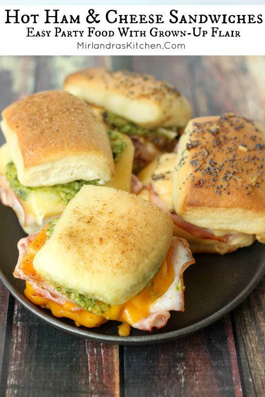 Hot ham sandwiches with cheese are dressed up with caramelized onions, pesto, olive tapenade or sun dried tomatoes. They make perfect party food or dinner!