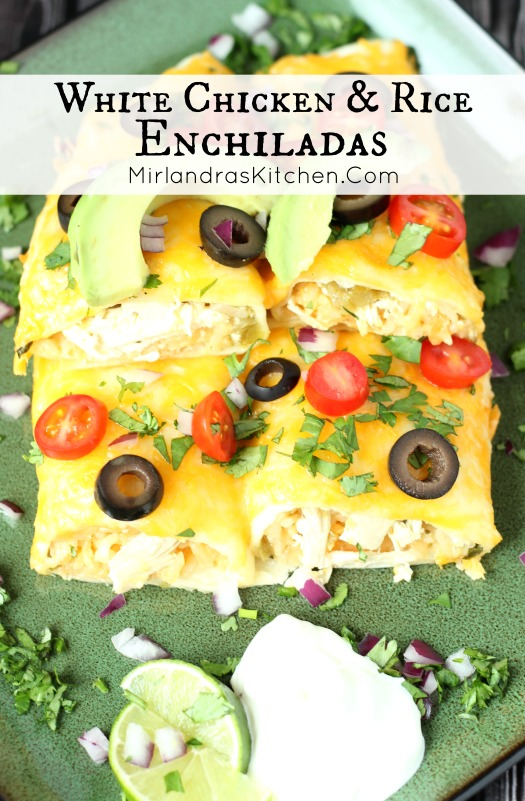 A green plate has four enchiladas stacked on it. They are garnished with olives, tomatoes and cilantro.