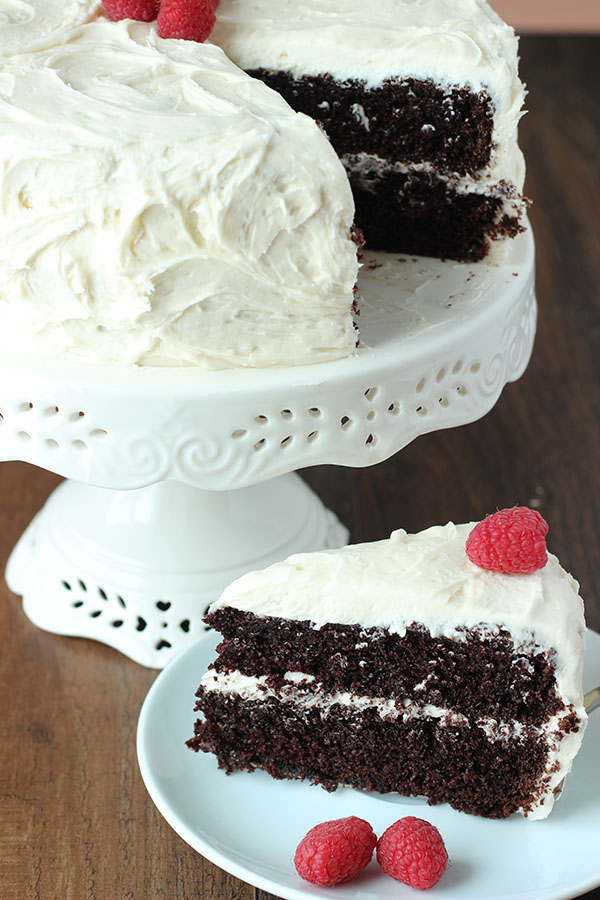This is the best chocolate cake! It is moist and decadent and so chocolaty. The cake is slathered in sweet, fluffy vanilla buttercream and decorated with raspberries!