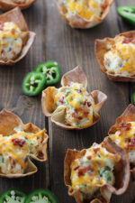Darling baked wonton wrappers are the perfect crunchy bowls to hold cheesy cream cheese and bacon jalapeno filling!