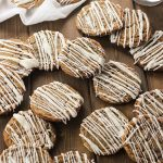 There is something magic about these soft ginger cookies with icing drizzle. The old fashioned flavor, the chew, and the drizzle add up to the perfect Christmas cookie! This recipe is also perfect for making in advance and storing in the freezer until you are ready to bake. Warm cookies on demand is my kind of life!