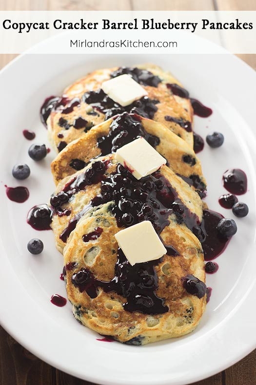 These crowd pleasing Cracker Barrel Blueberry Pancakes are ready in minutes and crazy good. The buttermilk pancakes are perfect in texture and flavor while wild blueberries add sweet bursts of tangy flavor. Top with my simple Wild Blueberry Syrup or your favorite topping.