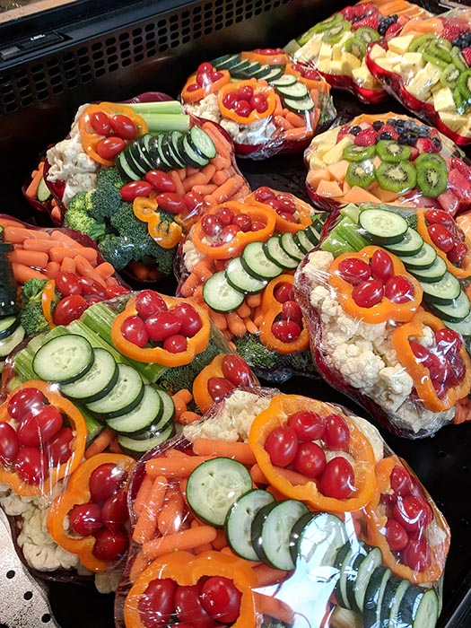 Elegant bowls of cut veggies ready to grab for snacks or a party at Albertsons on Broadway.