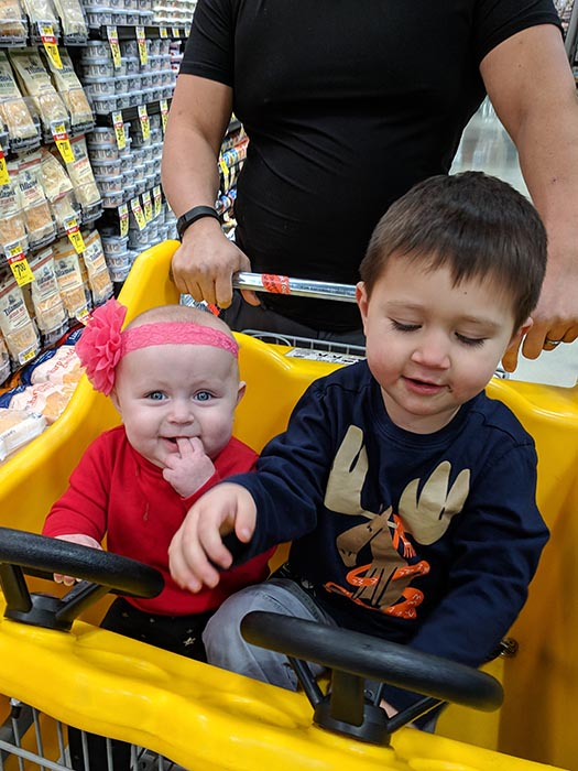 Jack Lionheart and Elora in a Taxi Cab shopping cart at Albertsons on Broadway.