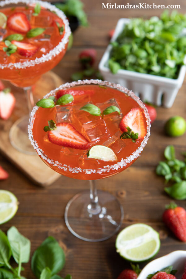 Homemade margaritas with triple sec and fresh ingredients.  These strawberry margaritas on the rocks are the perfect margarita.