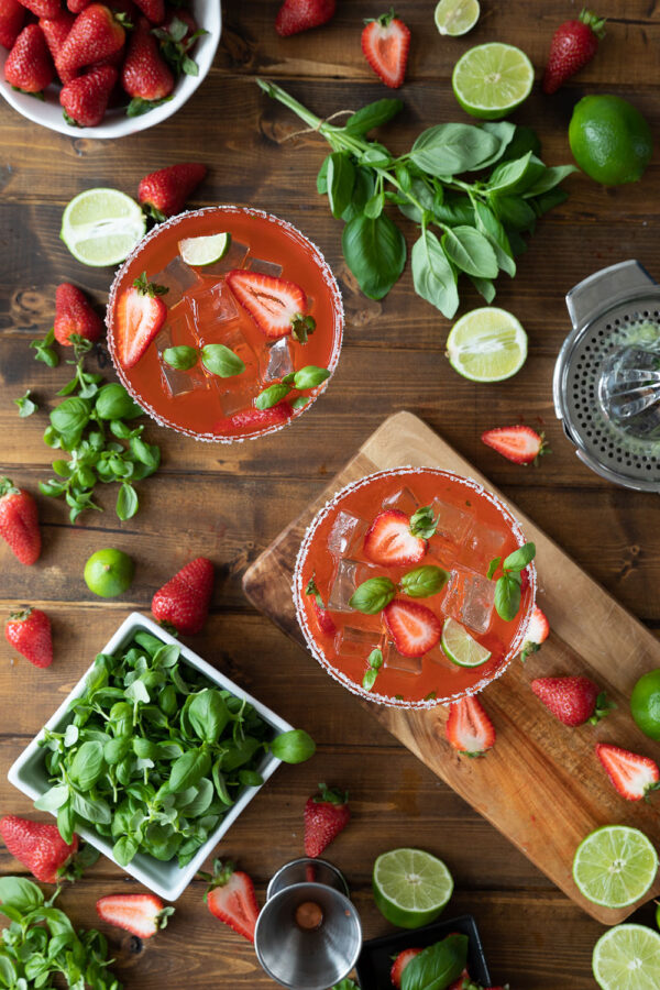 Easy, fresh strawberry basil margaritas on the rocks.  Made with citrus tequila fresh squeezed lime juice, triple sec, and basil microgreens.