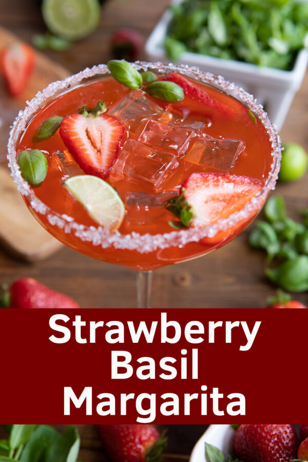 These fresh Strawberry Basil Margaritas are full of sweet strawberries, tart lime, citrus tequila and just a hint of spicy basil. Homemade margaritas are easy to whip up for Cinco De Mayo or a BBQ with friends. You don't need a blender or any special equipment to make these luscious on the rocks cocktails!