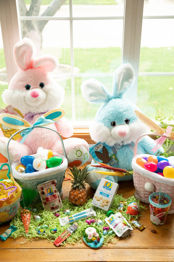 Big fluffy Easter bunnies, chocolate bunny ears from Dove, and cute bunny Easter baskets.  Healthy options like a mini pineapple and juice box and jerky are creative ideas for toddlers that make Easter fun!