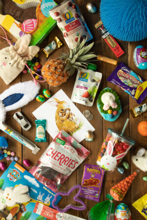 21 Creative ideas for a toddler Easter basket. There are more options than the traditional candy. Try a mini pineapple or some beef jerky or even a chap stick.