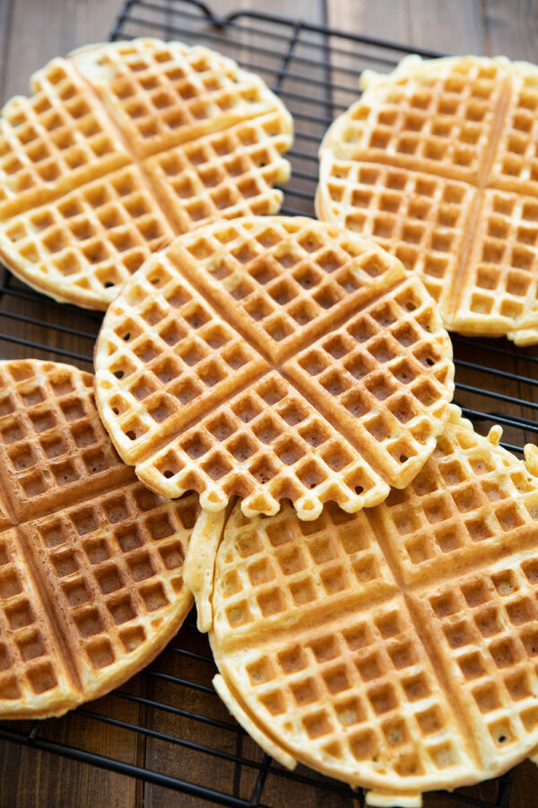Crispy, fluffy buttermilk waffles rest on a baking rack to prevent them getting soggy.  Never stack hot waffles!