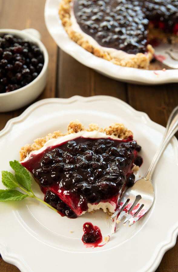 All dessert should be this easy and delicious!  This no-bake Huckleberry Cheesecake has a rich, buttery crumb and nut crust with just a hint of caramel to it!  The filling is light and fluffy - rich like a traditional cheesecake but not as heavy.  Over all this heaven a sweet layer of huckleberry topping brings it all together.