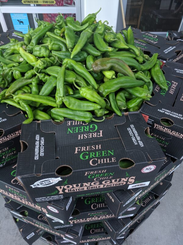 PIles of Hatch Chile peppers wait for Roasting at Albertsons in Boise, ID.