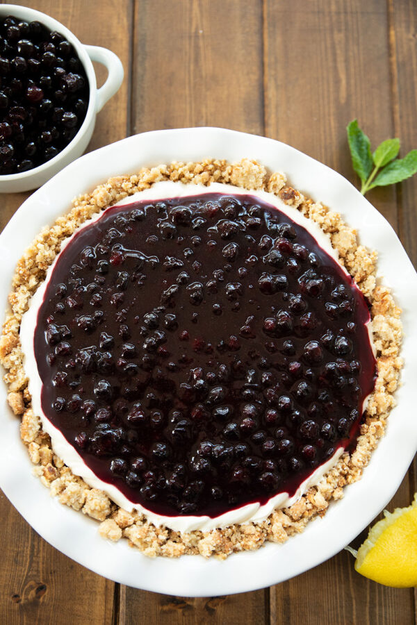 Perfect no bake huckleberry cheesecake.  A hint of lemon, a layer of sweet huckleberries, and a crunchy butter nut crust that has been perfectly toasted....  What more could you want?