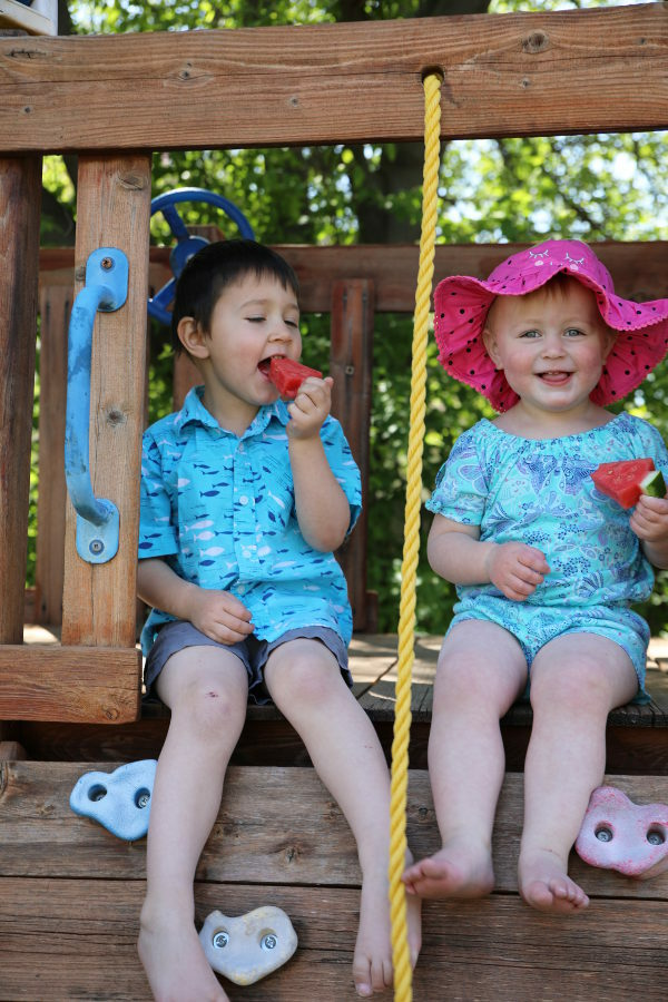 Jack and Ella in their play house eating watermelon trees.