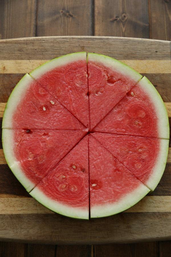 A slice of watermelon cut into 8 triangles.