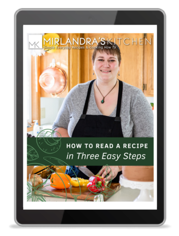 The cover of how to read a recipe free download displayed on a tablet. You can see the author, Mirlandra, cooking on the front cover.