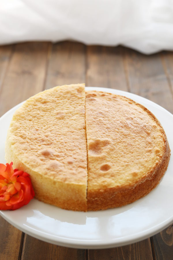 On the left you see half of a cake that rose flat and fluffy. On the right you see half a cake that didn't rise flat. This cake has darker edges and is dense.