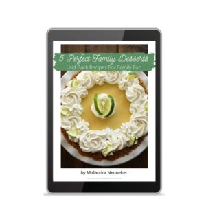 The cover of the cookbook Five Perfect Family Desserts shows on an Ipad.
