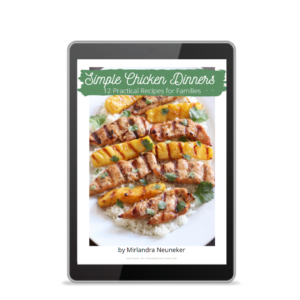 Cover of the Simple Chicken Dinners Cookbook showing grilled chicken and pineapple on rice.